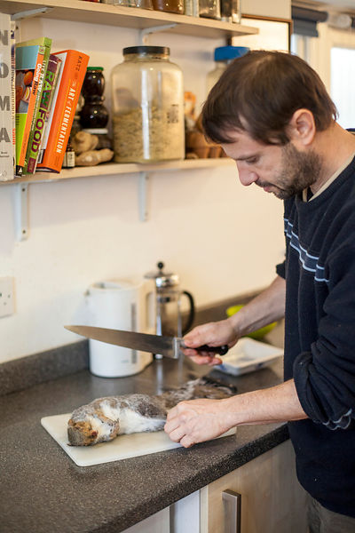 UK - Chartham - Fergus Drennan , known as 'Fergus the Forager' preparing a road-kill squirrel to eat at home