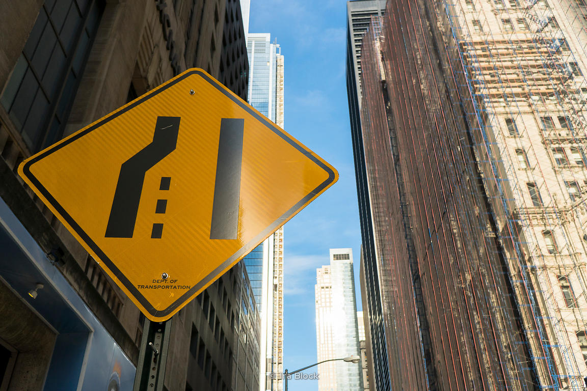 Light reflects of a road sign in lower Manhattan, New York City