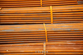 Rusty metal pipes stacked amongst each other in Xi'an, China.