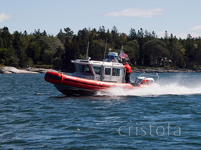 U S Coast Guard rib at speed along the Maine coast