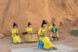 People playing mongolian music instruments at the Flaming Cliffs, Bayanzag, in the south Gobi desert, Mongolia.