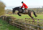 Nicholas Leeming jumping a hedge on Deane Bank