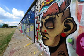 The East Side Gallery, one of the last remains of the Berlin Wall  that was painted by 118 artists from 21 countries,The long...
