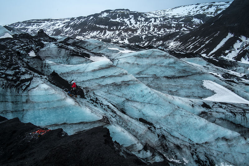 A mountaineer sets lines along a route while climbing a glacier in Iceland
