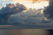 Fishing boat under a stormy sky at sunrise, Diani beach, Kenya