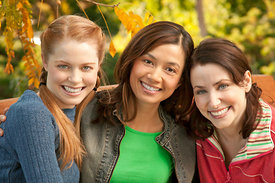 group of female friends pose for photo smiling