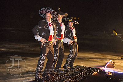 Josh Schamberger, Matt Phippen and Luke Eustice, dressed as the Three Amigos prepare to jump into the frigid water during the...