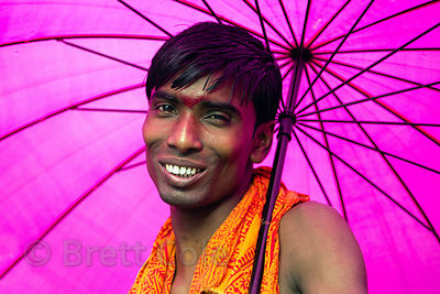 Man and his purple umbrella in monsoon rains, Babughat, Kolkata, India