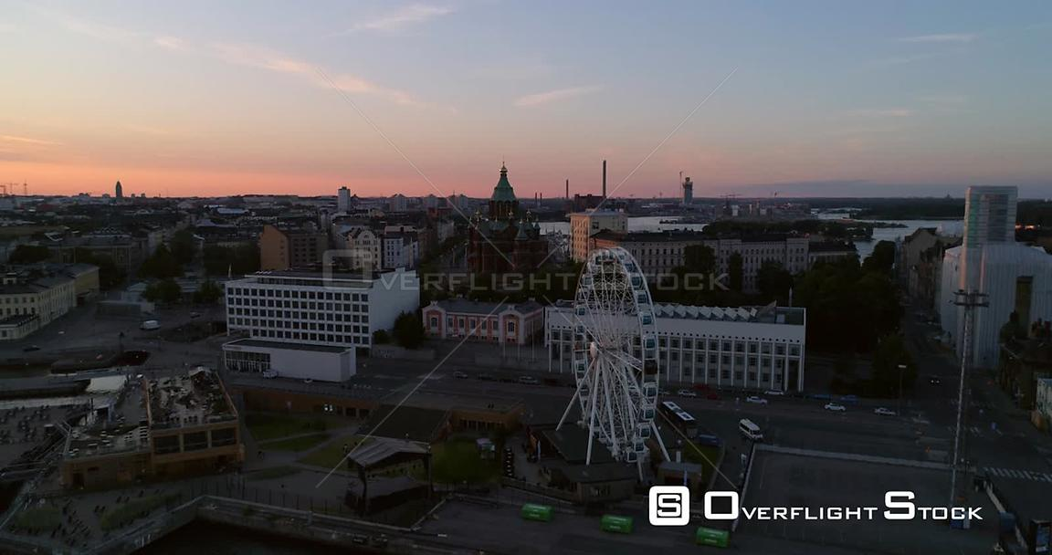 Sunset Cityscape, Aerial View Around the Helsinki Skywheel Ferris Wheel, Revealing the Market Square and South Harbour, on a ...