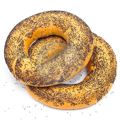 Bagel with poppy seeds on white background