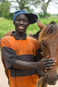 Young man with his horse, the Gambia