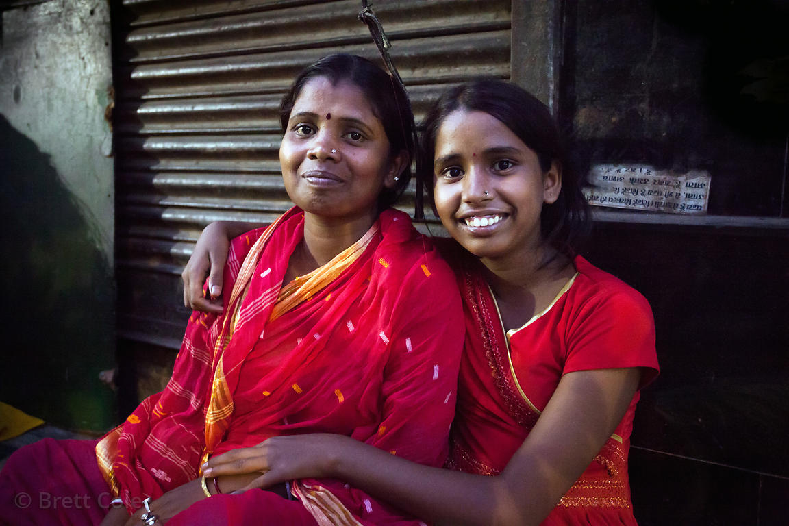 Lovely mother and daughter on the street at night in Kumartoli, Kolkata, India