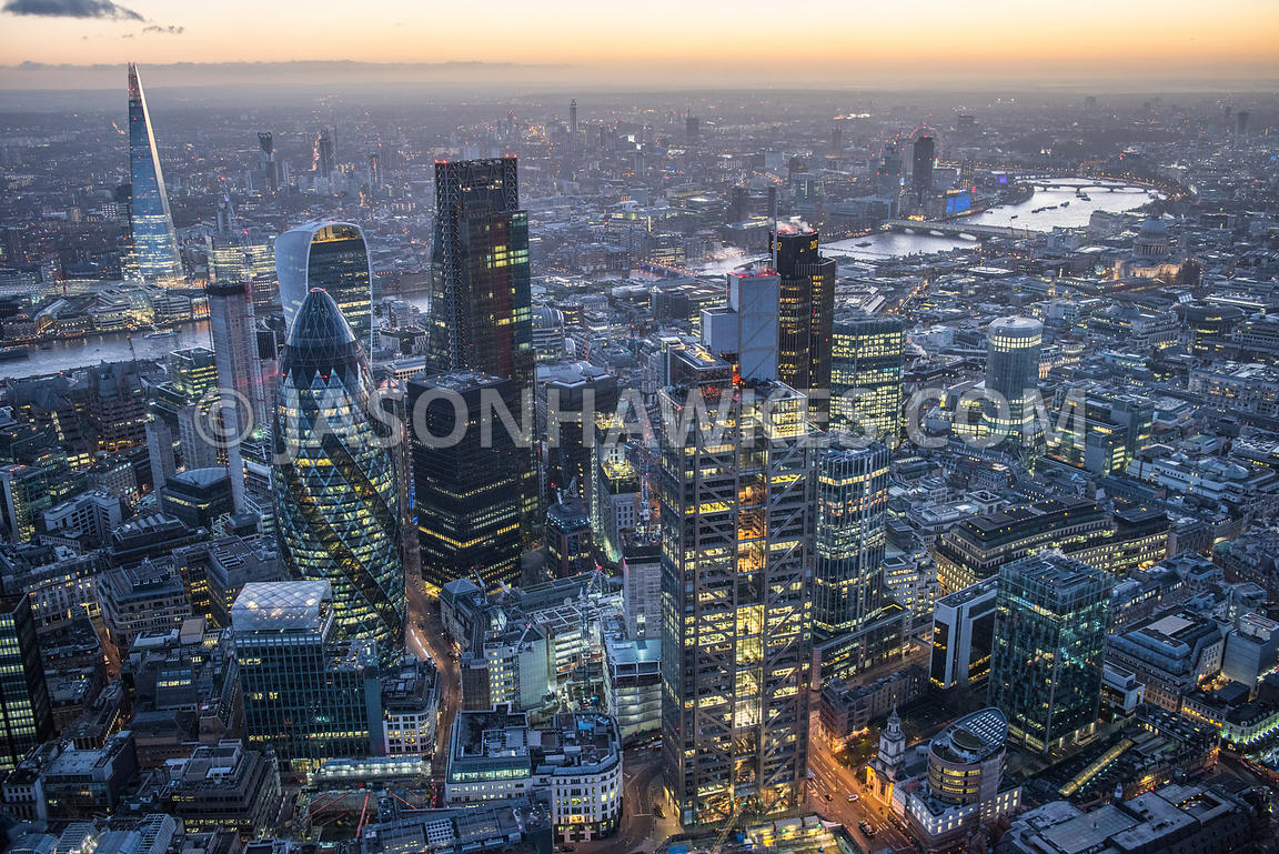 Dusk aerial view over the City of London. Heron Tower / Sales Force Tower, Swiss Re Tower, The Leadenhall Building, The Shard...