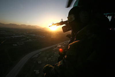 2009. An element of air commandos (CPA 30) secure a Caracal helicopter during an operation near Kabul.