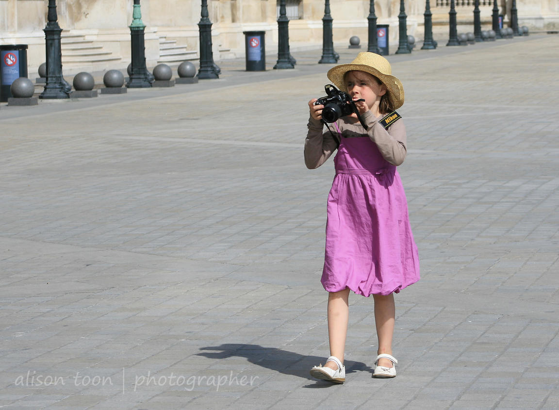 Girl in pink dress and sunhat, Paris, France