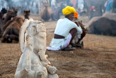 Ganesh statue and camel herders in Pushkar, Rajasthan, India