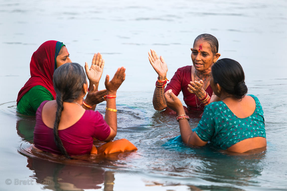 Women pray in the Ganges River, Haridwar, India