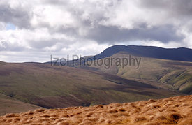 Views of Bowscale Fell and Blencathra from below High Pike in the English Lake District, UK.