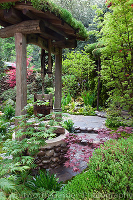 A well with decorative pebbles and Sedum roof in the Japanese garden Satoyama Life designed by Kazuyuki Ishihara at the RHS C...