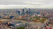 Aerial footage of Tower Bridge and The City, London