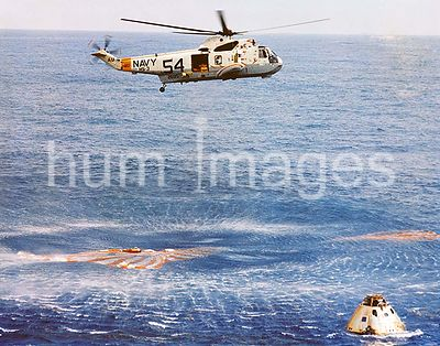 (13 March 1969) --- Immediately after splashdown a recovery helicopter from the USS Guadalcanal hovers over the Apollo 9 spac...