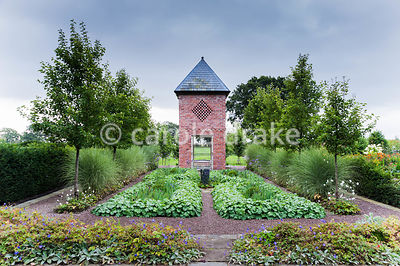 Dovecote built in 2007 to reflect the barn, with planting including Pyrus calleryana 'Chanticleer', Miscanthus sinensis 'Morn...
