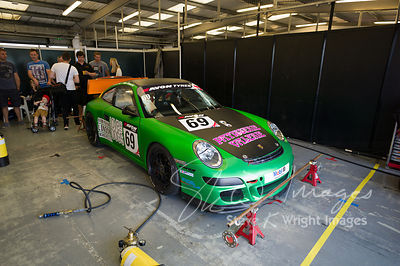 APO Motorsport's Porsche 911 GT4 in the pit lane, pre-race, at the Silverstone 500 - the third round of the British GT Champi...