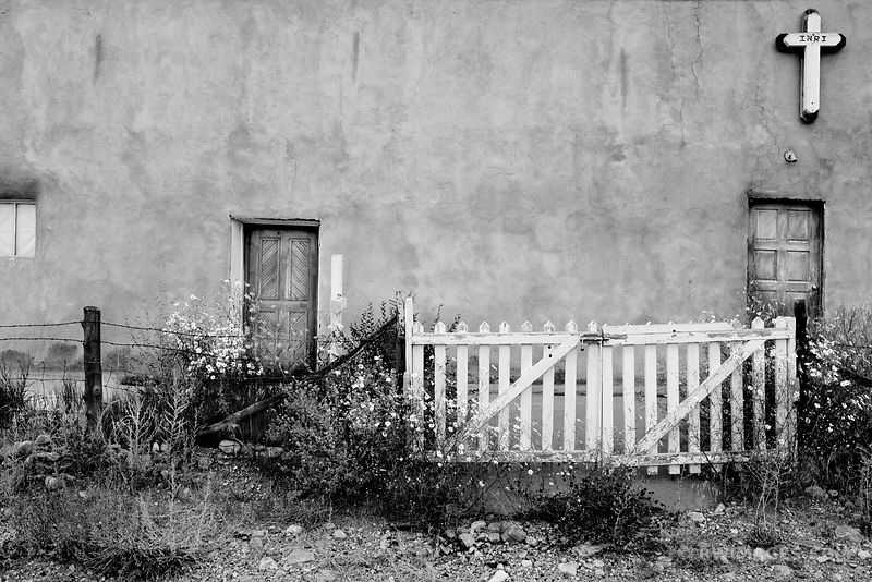 WALL WITH A CROSS RURAL NORTHERN NEW MEXICO BLACK AND WHITE