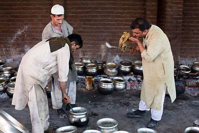 India - Srinagar - Khan Mohammed Sharief Waza, a traditional Kashmiri chef inspects and tastes dishes at a Wazwan, a Kashmiri...