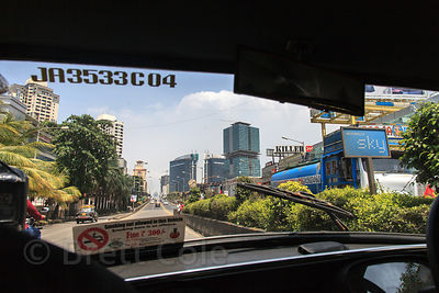 View of Mumbai, India near Mahim, through the windshield of a taxi.