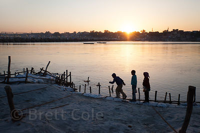 Children play along the banks of the Ganges River at the 2013 Kumbh Mela, Allahabad, India.