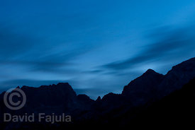 Mountain range at dusk in Triglav National Park. From left to right; Nizki vrh (2162 m) Zadnji Pelc (2315 m) Pelc nad Klonicami (2442 m) Mali Ozebnik (2324 m) Špiček (2192 m) Vrh Zelenic (2278 m) Veliki Ozebnik (2480 m) Jalovec (2645 m)