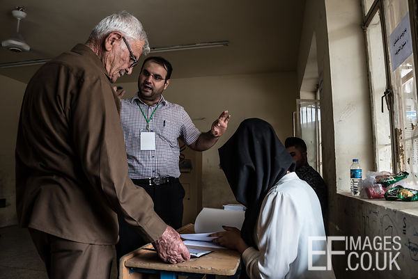 A polling station employee remonstrates with a prospective voter in the Kurdish Independence Referendum in Iraqi Kurdistan be...