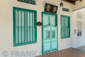 Colourful residence with window shutters on Emerald Hill Road, a  conservation area in the colonial Chinese baroque style arc...