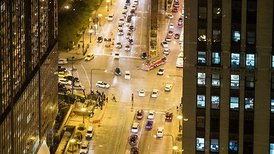 Bird's Eye: Close Up Shot of Car & Pedestrian Ladden Intersection of Michigan Avenue & Randolph