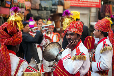 Band members play in a Sikh parade in the Paharganj area of Delhi, India
