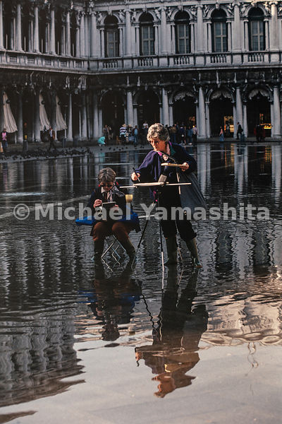 Artists sketch in front of Piazza San Marco regardless of the acqua alta that occurs in the Veneto region. Venice, Italy, Oct...