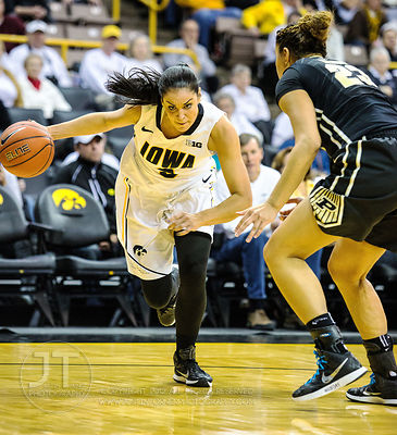 Iowa's Claire Till (3) drives the baseline versus Purdue's Liza Clemons (23) during the second half of play at Carver-Hawkeye...