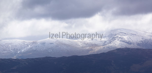 A snow covered Helvellyn in the Lake District with Raise and White Side to the left.