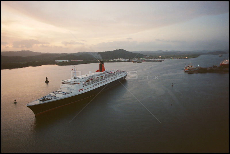 PANAMA Balboa -- The famous cruise ship Queen Elizabeth II transits the Panama Canal en route to the Pacific ocean. Hundreds ...