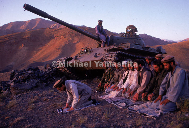 Massoud, theLion of Panjshir, leads his officers in evening prayer.