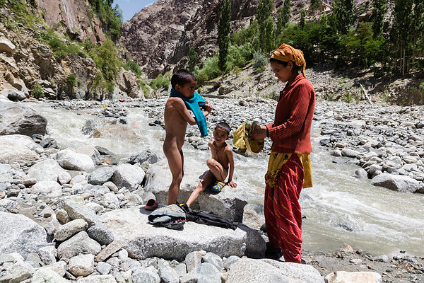 Road Labourer Bathing her Kids in a Stream