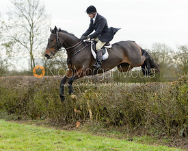 Tim Edwards jumping a hedge on Graham Smith's