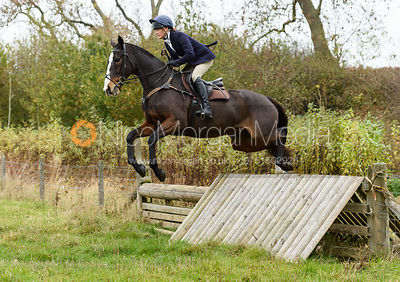Isobel McEuen jumping a hunt jump near Peake's. The Cottesmore Hunt at Somerby