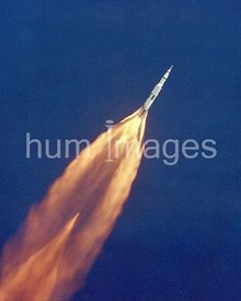 The Apollo 11 Saturn V space vehicle climbs toward orbit after liftoff from Pad 39A at 9:32 a.m. EDT.