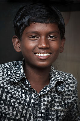 Portrait of a boy on Strand Road in Kolkata, India.