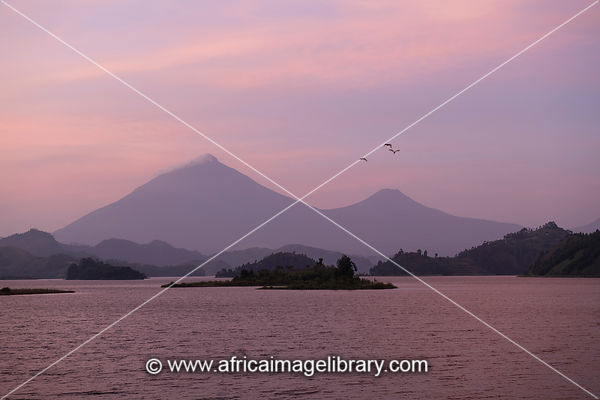Lake Mutanda with views of volcanoes of the Virunga Mountains, Uganda