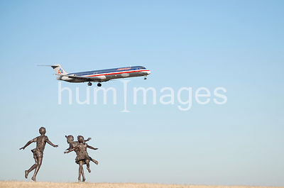 Statue of kids playing at Dallas Fort Worth Airport's Founder's Plaza (with airplane)