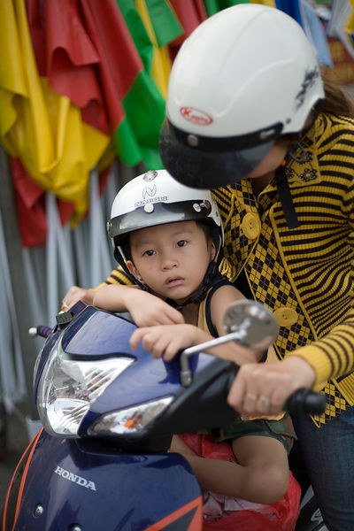 A mother and her son on a scooter