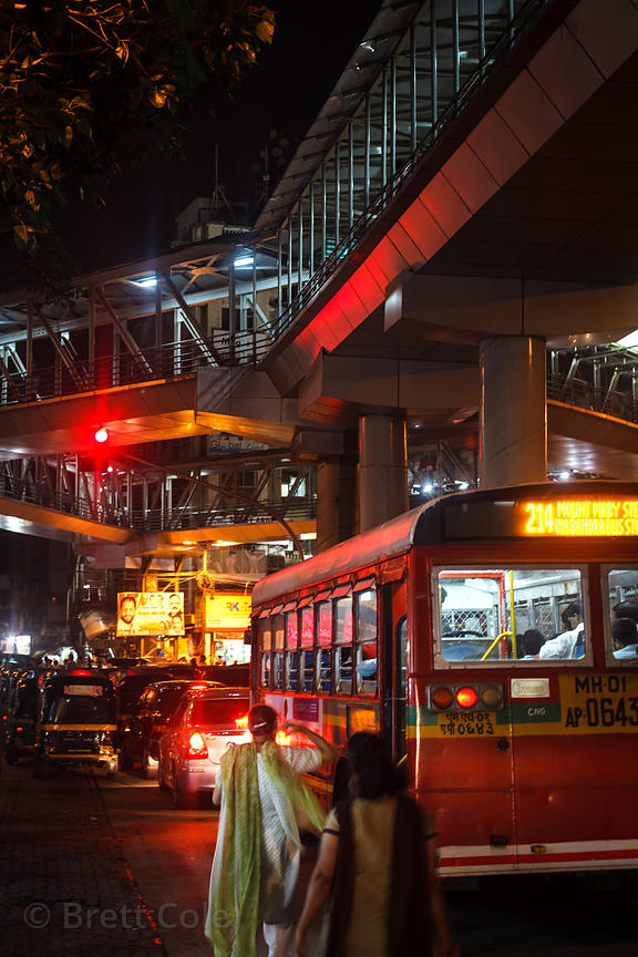 Nighttime view of traffic near Bandra Railway Station, Mumbai, India.